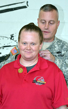 <i>Guard unit honors soldier's spouse for 'relentless support'</i>