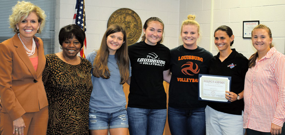 <i>School board honors coach of year Erica Wammock</i>