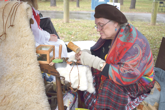 <i>Showers fail to dampen fun at 'River of Yesteryear'</i>
