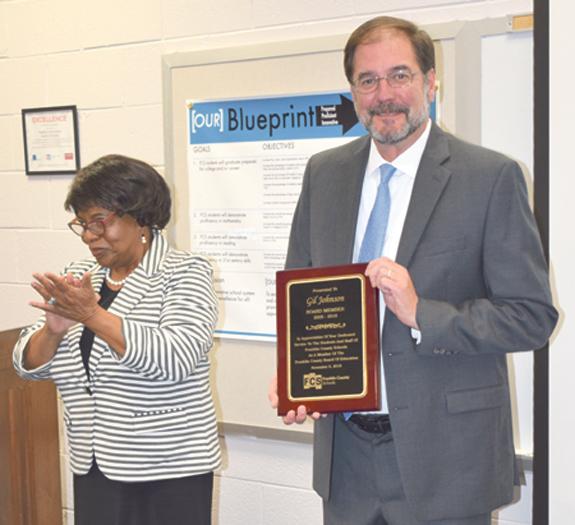 <i>School board salutes outgoing member</i>