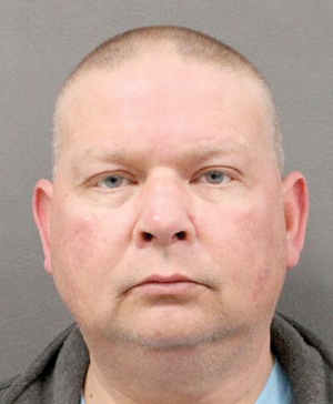 Middlesex police chief is charged with assault