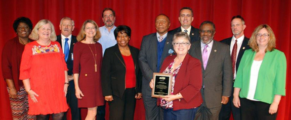 <i>Commissioners honored for commitment to schools</i>
