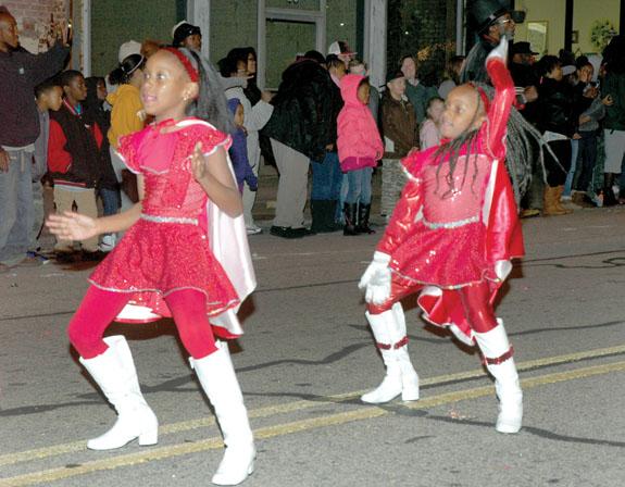 Parades mark beginning of Christmas season, 1