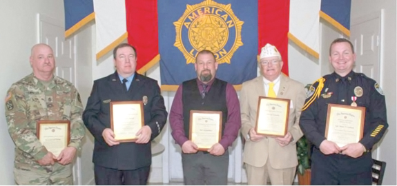 <i>Franklinton Legion Post salutes others</i>