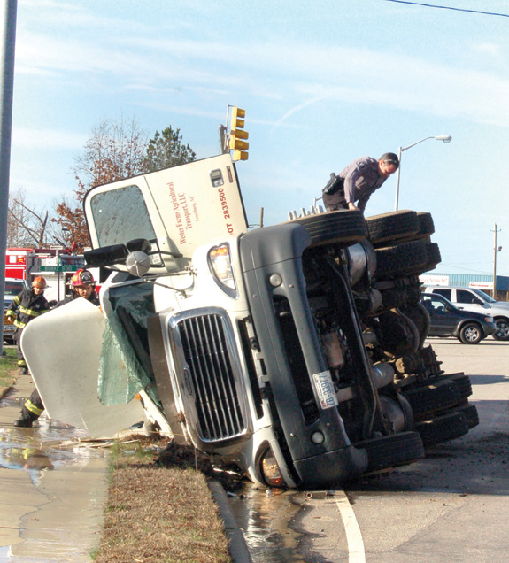 Transport truck rolls at intersection